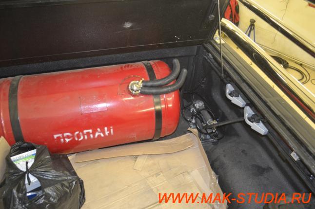 Расположение компрессора в багажном отсеке.