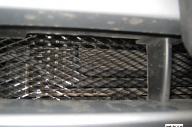Главная защита радиатора в нижней части
