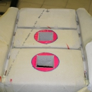 Далее размечаем места установки вентиляторов и вырезаем паролоновую подушку на нужную величину, а так же спец.инструментом уменьшаем высоту самой подушки, для установки вентиляционной прокладки